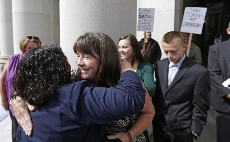Stephanie McCleary was embraced outside the state Supreme Court.